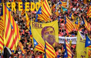 "(FILES) In this file photo taken on September 11, 2018 demonstrators hold a banner demanding freedom for Catalan jailed leader Oriol Junqueras as they gather to take part in a pro-independence demonstration in Barcelona, on September 11, 2018, marking the National Day of Catalonia, the ""Diada"". Spain's Supreme Court ordered on October 25, 2018, 18 former Catalan leaders, to stand trial over their role in last year's declaration of independence. Nine former leaders, including Catalonia's ex-vice president Oriol Junqueras, who are in pre-trial detention should be tried for rebellion, the court said. The crime of rebellion carries a prison sentence of up to 25 years.  / AFP / LLUIS GENE"